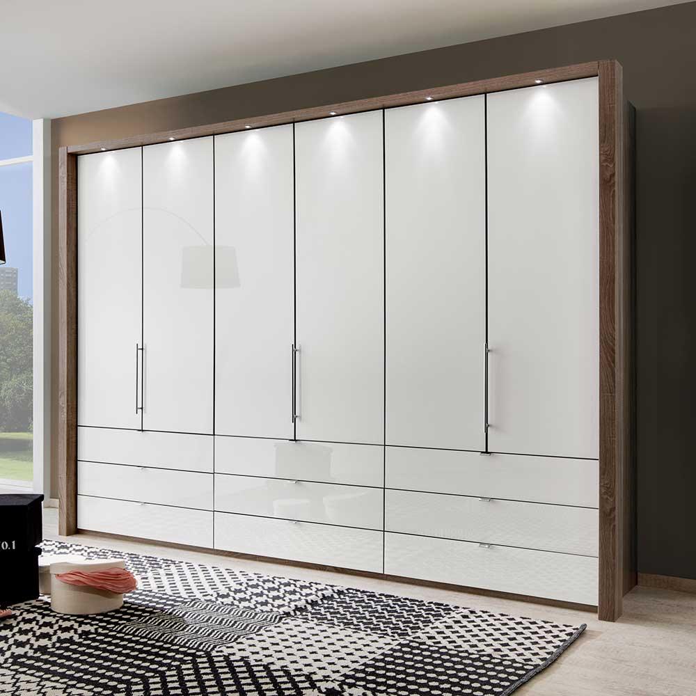 Falttüren Kleiderschrank in Weiß Braun LED Beleuchtung