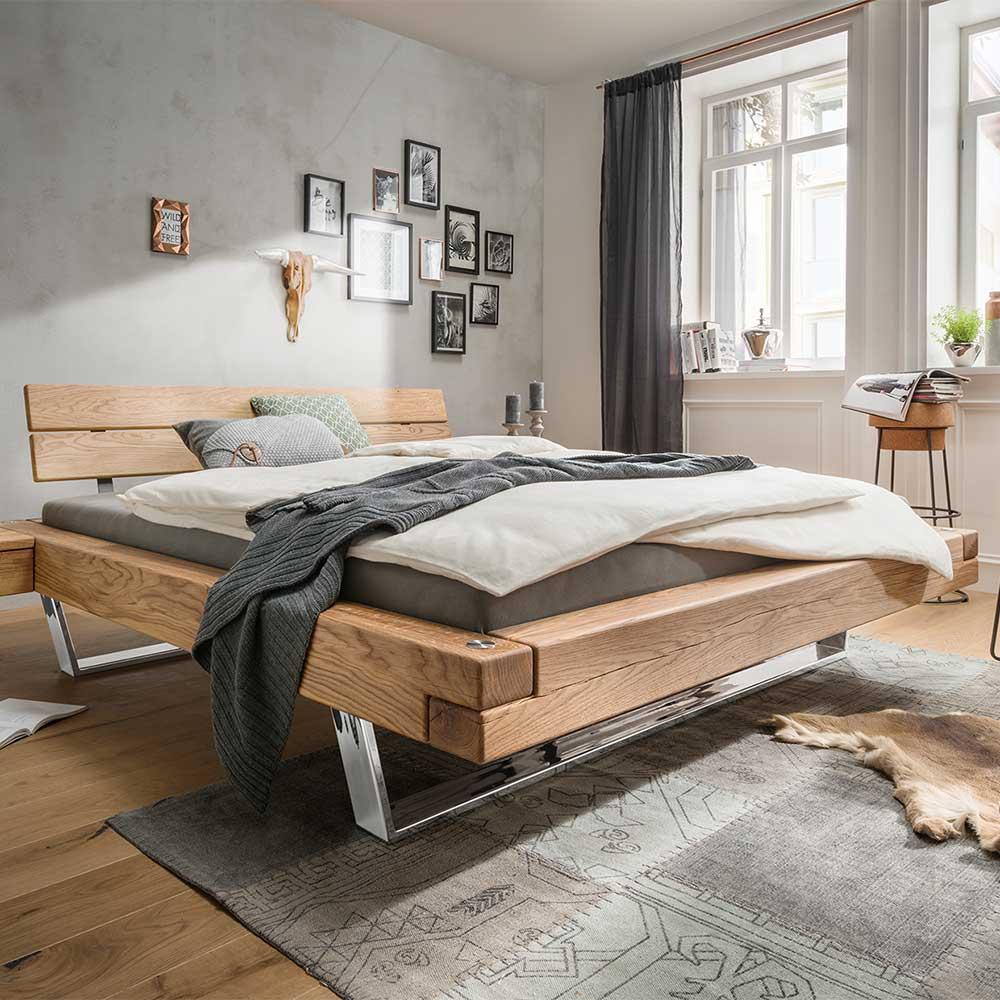 Bett aus Wildeiche Massivholz Kufengestell aus Edelstahl